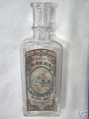 "A vintage empty ""Seely's Opera Hair Oil"" advertising bottle. Bottle stands 5 3/4"" in height."