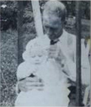 Nehemiah Ezekiel holding baby George
